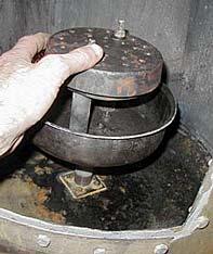 Quemador atornillado al fondo de la estufa